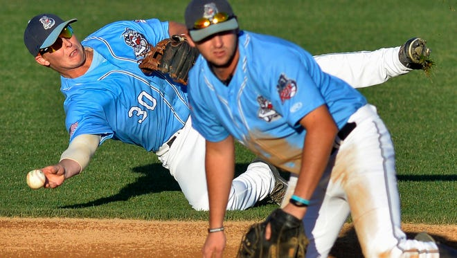 Rox second baseman Liam Bedford (30) makes a diving throw to first after the ball got between him and first baseman Clay Ardeeser (29) in the first inning Tuesday at Joe Faber Field.