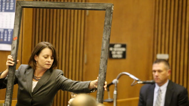 Defense attorney Cheryl Carpenter questions Dearborn Heights police Cpl. Mark Parrinello at the trial of Theodore Wafer, who is accused of killing Renisha McBride on his porch Nov. 2. Carpenter said doors weren't dusted for prints until Nov. 11.