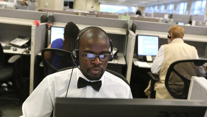 Keontay Kelley, 26, of Detroit works as a customer service representative at Dialog Direct, a call center in Highland Park, Mich. Wednesday, July 30, 2014.
