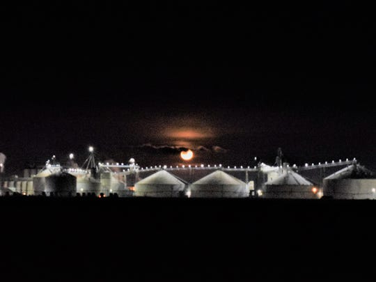 The Supermoon glows above Mountaire Farms' Millsboro-area poultry plant on Del. 24.