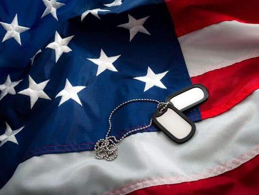 Dog tags and the American flag