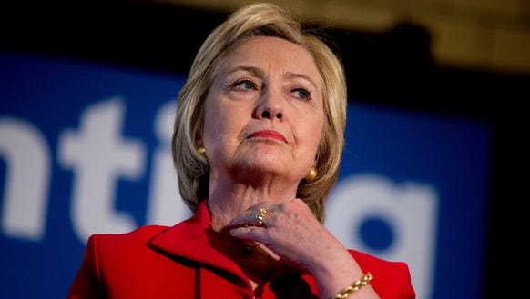 Democratic presidential candidate Hillary Clinton waits