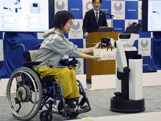 Tokyo Olympic organizers on Friday showed off robots that will be used at the new National Stadium.
