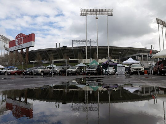 "FILE - In this Dec. 24, 2015, O.co Coliseum is reflected in a puddle before an NFL football game between the Oakland Raiders and the San Diego Chargers in Oakland, Calif. NFL Commissioner Roger Goodell says the existing stadiums in St. Louis, San Diego and Oakland are ""inadequate and unsatisfactory,"" and that the proposals the Rams, Chargers and Raiders received to remain in their current cities lacked certainty. A person who has seen the report told The Associated Press on Saturday night, Jan. 9, 2016, that the NFL commissioner sent a 48-page report to team owners and cited a lack of longer-term solutions in plans to build new facilities. The person spoke on condition of anonymity because the league has not released details of the report. (AP Photo/Jeff Chiu, File)"