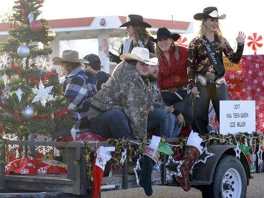 2017 Fernley Rodeo Association Teen Queen Izze Miller and friends ride on a float.