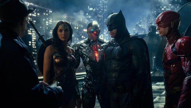 Commissioner Gordon (J.K. Simmons, left) meets up with Wonder Woman (Gal Gadot), Cyborg (Ray Fisher), Batman (Ben Affleck) and The Flash (Ezra Miller).