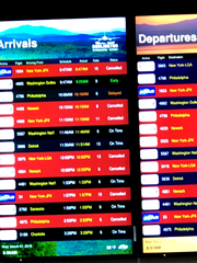 Cancelled flights in and out of Burlington International Airport (in red) dominate a sign Wednesday morning, March 7, 2018.