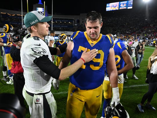 Dec 16, 2018; Los Angeles, CA, USA; Philadelphia Eagles quarterback Nick Foles (9) meets with Los Angeles Rams offensive tackle Rob Havenstein (79) after the Eagles beat the Rams 30-23 at Los Angeles Memorial Coliseum. Mandatory Credit: Robert Hanashiro-USA TODAY Sports
