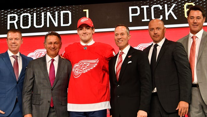 Filip Zadina poses for a photo with Detroit Red Wings team personnel, after being selected as the No. 6 overall pick in the first round of the 2018 NHL Draft at American Airlines Center in Dallas on June 22..