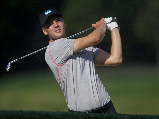 Martin Kaymer of Germany, looks at his shot from the seventh fairway during the second round of The Players championship golf tournament at TPC Sawgrass, Friday, May 9, 2014 in Ponte Vedra Beach, Fla. (AP Photo/Gerald Herbert)