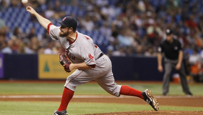 Then-Boston Red Sox pitcher Alex Wilson works in the fifth inning against the Tampa Bay Rays at Tropicana Field on Aug. 30, 2014. Wilson was traded to the Tigers Thursday as part of the Rick Porcello-for-Yoenis Cespedes deal