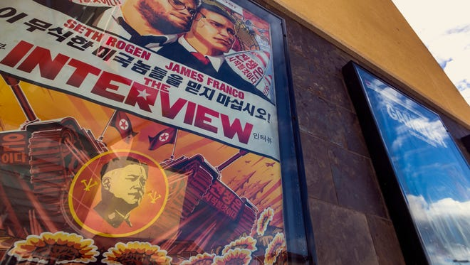 "A movie poster for the movie ""The Interview"" is displayed outside the AMC Glendora 12 movie theater  Wednesday, Dec. 17, 2014, in Glendora, Calif."