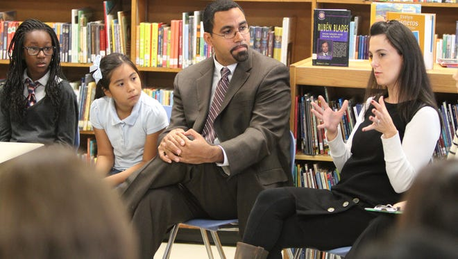 New York State Education Commissioner John King listens to ESL teacher Shawna Squillace as he speaks with educators following a tour of JFK Magnet Elementary School in Port Chester Oct. 10, 2013. ( Matthew Brown  / The Journal News )