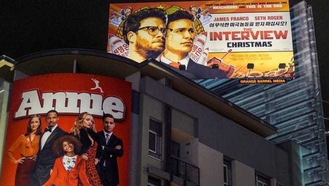 """FILE - In this Wednesday, Dec. 17, 2014 file photo, a banner for """"The Interview"""" is posted outside Arclight Cinemas in the Hollywood section of Los Angeles. Sony Corp.'s miseries with its television and smartphone businesses were bad enough. Now its American movie division, a trophy asset, is facing tens of millions of dollars in losses from leaks by hackers that attacked the company over the movie that spoofs an assassination of North Korean leader Kim Jong Un. Sony Pictures canceled all release plans for the film at the heart of the attack. (AP Photo/Damian Dovarganes, File)"""