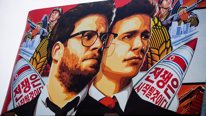 """A banner for """"The Interview""""is posted outside Arclight Cinemas, Wednesday, Dec. 17, 2014, in the Hollywood section of Los Angeles. A U.S. official says North Korea perpetrated the unprecedented act of cyberwarfare against Sony Pictures that exposed tens of thousands of sensitive documents and escalated to threats of terrorist attacks that ultimately drove the studio to cancel all release plans for """"The Interview."""""""