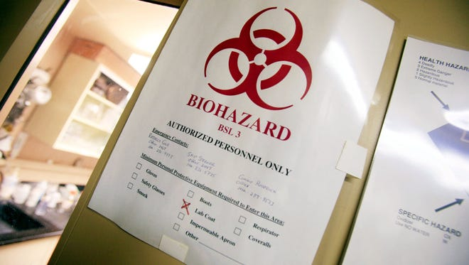 Bio hazard warning signs line the walls at the USGS National Wildlife Health Center May 25, 2006 in Madison, Wisconsin.