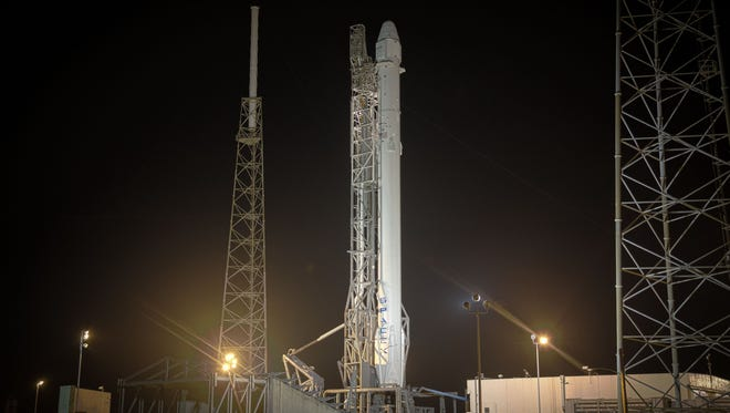 A SpaceX Falcon 9 rocket and Dragon cargo spacecraft on the pad at Cape Canaveral Air Force Station's Launch Complex 40 before a Jan. 6 launch attempt.