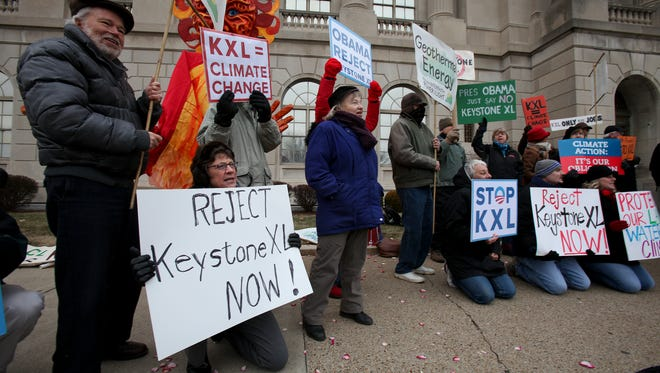 Rhoder Streeter, left, and Judy Lyons attend a protest of the Keystone XL Pipeline in front of the federal courthouse at 6th and Broadway. Jan. 13, 2014