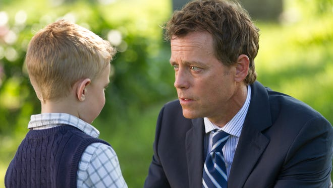 """Connor Corum, left, and Greg Kinnear in a scene from """"Heaven Is For Real."""""""