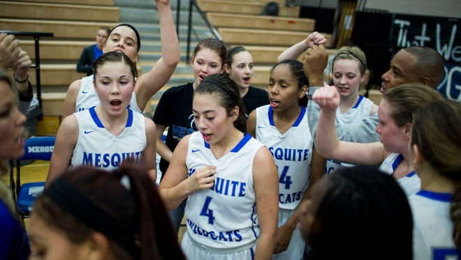 The Mesquite girls basketball team celebrates its win over Chandler at a Mesquite home game Jan. 16, 2015 in Chandler.
