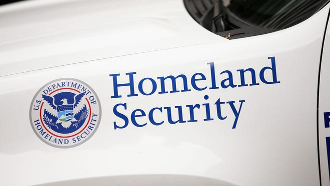 A Homeland Security police vehicle sits outside the federal building complex in Chicago.