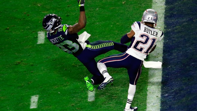 Malcolm Butler #21 of the New England Patriots intercepts a pass by  Russell Wilson #3 of the Seattle Seahawks intended for  Ricardo Lockette #83 late in the fourth quarter during Super Bowl XLIX at University of Phoenix Stadium on February 1, 2015 in Glendale, Arizona.