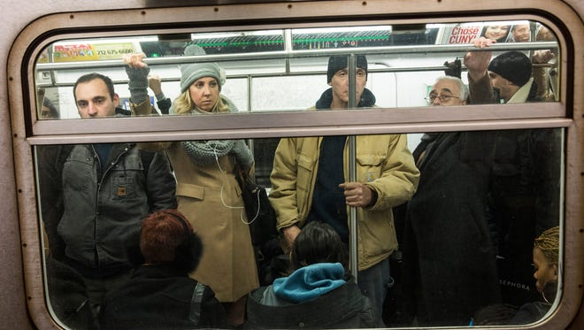People ride an uptown 5 train at Union Square on Jan. 28, 2015, in New York City.