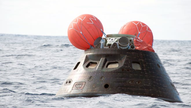 SAN DIEGO, Calif. -- NASA's Orion spacecraft floats in the Pacific Ocean after splashdown from its first flight test in Earth orbit on Dec. 5, 2014. The spacecraft completed a two-orbit, four-and-a-half-hour mission in Earth orbit.