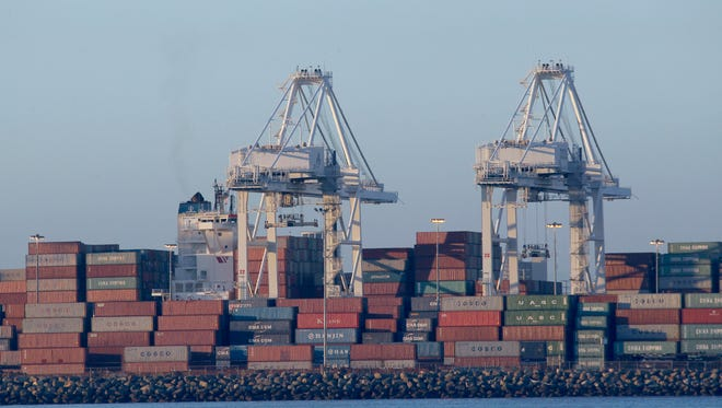 Cargo containers are seen on top of ships anchored off the Long Beach Harbor waiting to be unloaded due to a labor dispute, as seen from a whale watching ship in Long Beach, Calif.. Port operators and dock workers are negotiating a new contract.