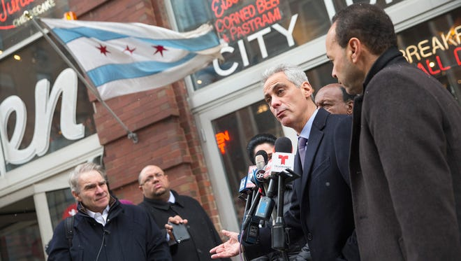 Chicago Mayor Rahm Emanuel speaks to the press after leaving a restaurant where he had lunch with U.S. Representative Luis Gutiérrez (D-IL), Illinois Secretary of State Jesse White and Chicago City Clerk Susana Mendoza on election day February 24, 2015 in Chicago, Illinois.
