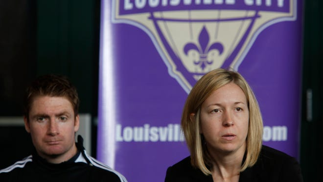 Amanda Duffy, General Manager for the Louisville City Football Club, right,  spoke with the media today about the club's innaugural season, while head coach James O'conner looked on.  March 2, 2015.
