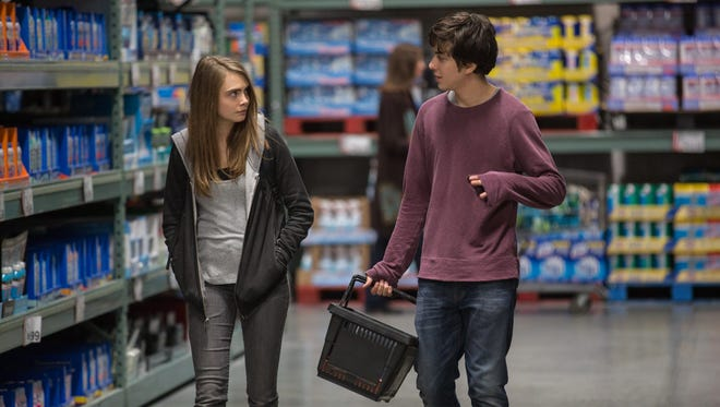 Supermodel Cara Delevingne with Nat Wolff in 'Paper Towns.'