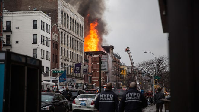 A building burns after an explosion on Second Avenue on March 26, 2015, in New York City.