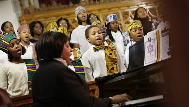 Deirdre Thompson and the Cherubic Choir perform during the Fifteenth Annual World Sabbath of Religious Reconciliation at Hartford Memorial Baptist Church in Detroit in 2014.