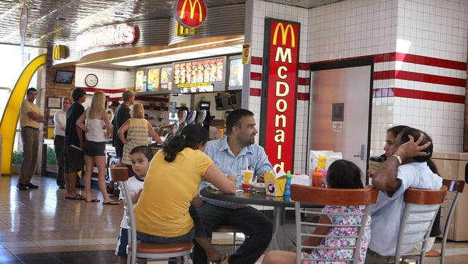 Customers eat at a McDonald's restaurant in Schiller Park, Ill.