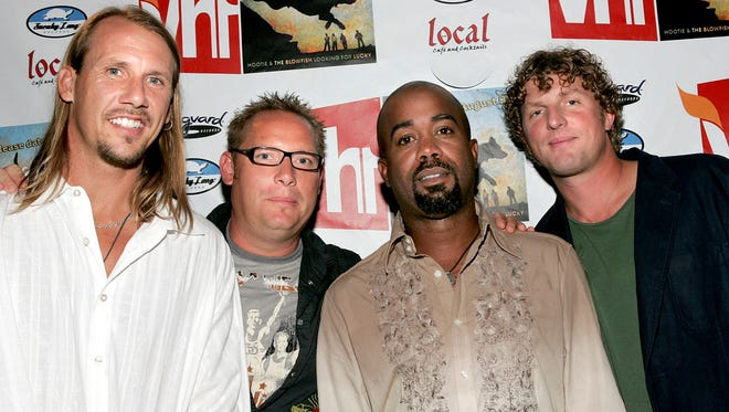 """NEW YORK - AUGUST 8: (L-R) Hootie and the Blowfish band members Jim """"Soni"""" Sonefeld, Dean Felber, Darius Rucker and Mark Bryan attend a listening party for their new CD """"Looking for Lucky"""" at Local 1 August 8, 2005 in New York City. (Photo by Paul Hawthorne/Getty Images)"""