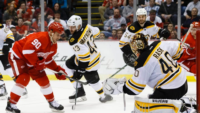 Boston Bruins goalie Tuukka Rask (40) makes a save in front of Detroit Red Wings center Stephen Weiss (90) in the third period at Joe Louis Arena.