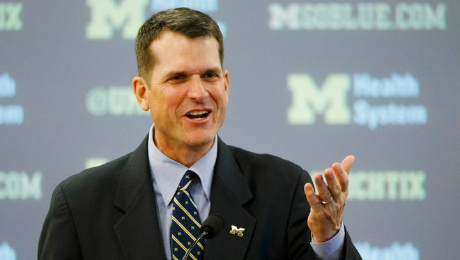 Jim Harbaugh speaks at his introductory press conference in December.