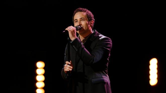 "Michigan's Joshua Davis performed an intense Simon & Garfunkel's ""America"" on ""The Voice"" this week."