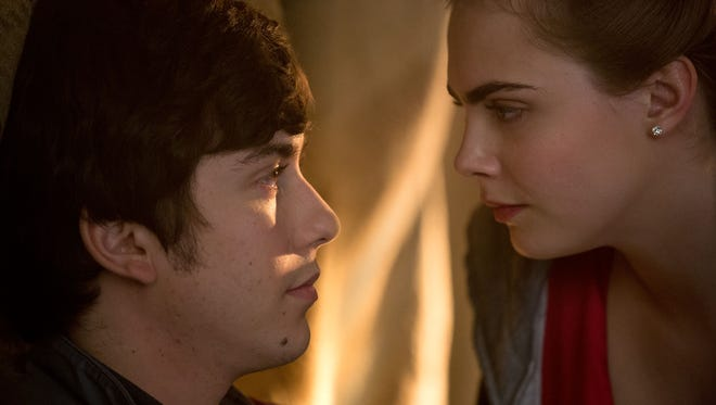 Margo (Cara Delevingne) and Quentin (Nat Wolff) share a moment during an all-night adventure in a scene from 'Paper Towns.'