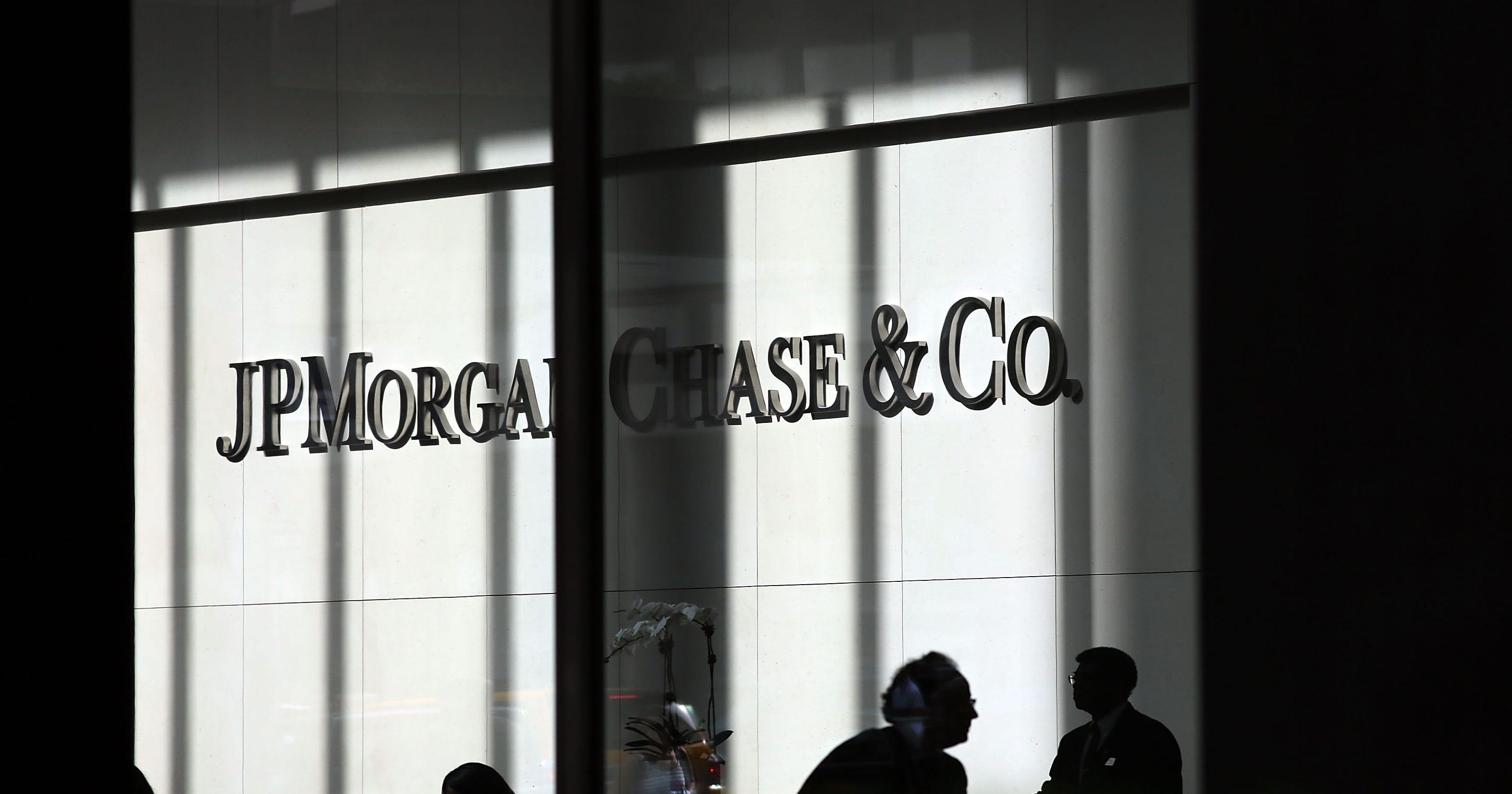 Ex-JPMorgan adviser charged in $20M fraud