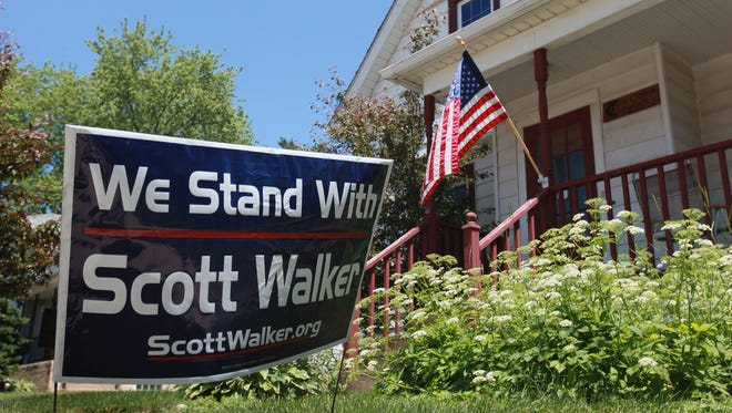 A sign supporting Wisconsin Governor Scott Walker stands outside a home June 4, 2012 in Clinton, Wisconsin. Some of Walkers supporters have been targeted by home invasions recently.