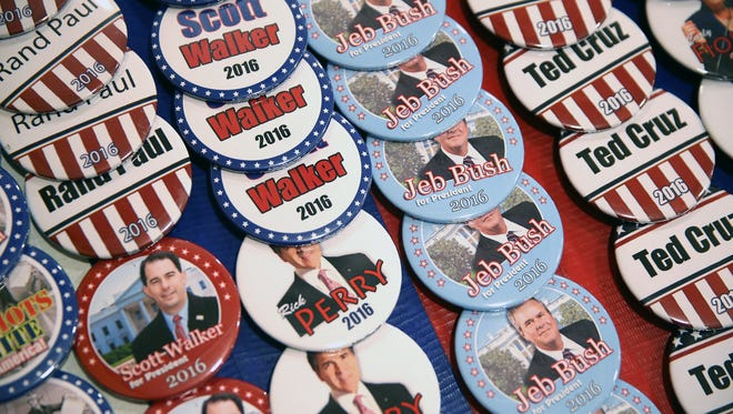 Campaign buttons as Saturday's Iowa Faith and Freedom Coalition event, which featured Republican presidential hopefuls.