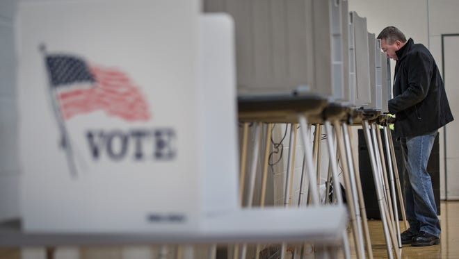 A man votes at Carl Traeger Middle School in Oshkosh during the spring election earlier this month.