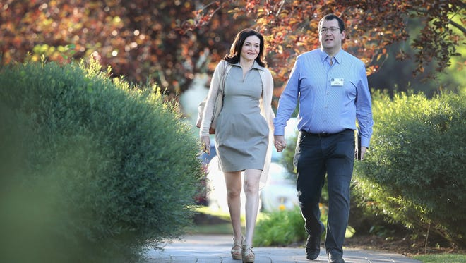 Sheryl Sandberg, chief operating officer of Facebook, and her husband David Goldberg, CEO of SurveyMonkey, attend the Allen & Company Sun Valley Conference on July 9, 2014, in Sun Valley, Idaho.