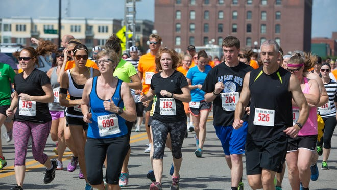 Runners participate in a 5K race/run/walk for a good cause in Des Moines.