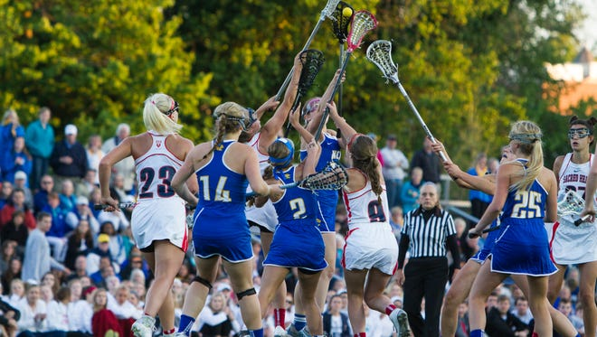 Sacred Heart and KCD players battle for possession of the ball during the first half of the 2015 Girls' Lacrosse State Championship at Sacred Heart Academy. May 21, 2015.