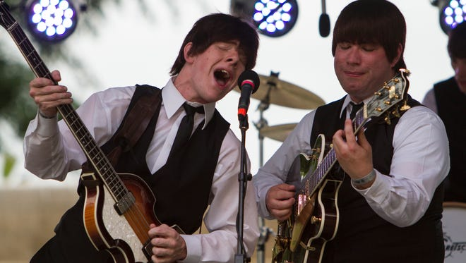 Al Francis, left, and Robert Murray of Beatles Tribute Band: Studio Two, perform Sunday afternoon during the Abbey Road on the River music festival. May 25, 2015.