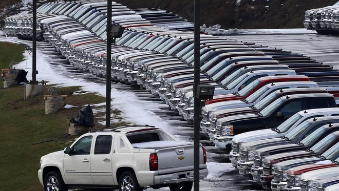 FILE - In this Wednesday, Jan. 9, 2013 file photo, Chevy trucks line the lot of a dealer in Murrysville, Pa. Many local auto dealerships are overflowing with sedans, trucks and SUVs, so there are deals to be had. Most dealers have abundant supplies of 2013 models, and 2014s are arriving as automakers keep their factories humming. Since dealers pay interest on money borrowed to buy the cars, they're probably anxious to sell them by the end of the year. (AP Photo/Gene J. Puskar)