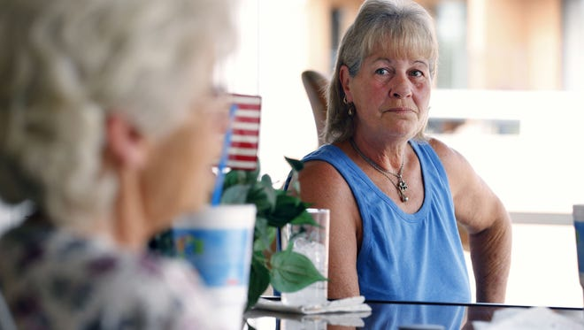 Resident Donna Higgs, left and Deett Breedlove talk about the possibility of being forced from their homes at the Wheel Inn Ranch Wednesday, May 27, 2015 in Scottsdale, Ariz. The Scottsdale residents at Wheel Inn Ranch RV Park may be forced to move because a developer bought the land and plans to build a luxury apartment complex in its place.